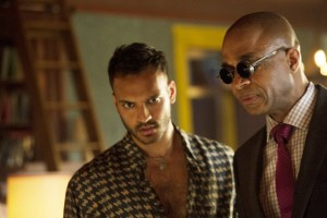 "THE MAGICIANS -- ""The World in the Walls"" Episode 104 -- Pictured: (l-r) Arjun Gupta as Penny, Rick Worthy as Dean -- (Photo by: Carole Segal/Syfy)"